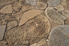 Broken millstones. Used at the time to cover the wall floors of a medieval castle in Algarve, Portugal. Sights of Europe stock photos