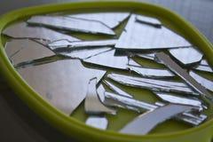 Broken mirror. In small pieces Royalty Free Stock Photos