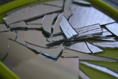 Broken mirror. In small pieces royalty free stock photos