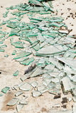 Broken mirror glass shards. Spread on the floor stock photography