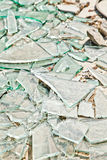 Broken mirror glass shards. Spread on the floor stock photo
