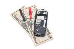 Broken Mobile Phone And Dollars Royalty Free Stock Image
