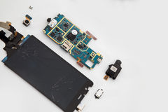 Broken mobile phone. Parts and components royalty free stock image
