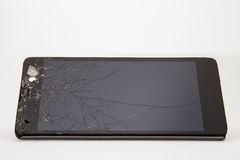 Broken mobile phone. Parts and components royalty free stock images