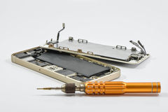 Broken of mobile phone and repair tool. On white screen royalty free stock photography