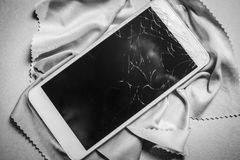 Broken mobile phone screen, black and white frame.  royalty free stock photography