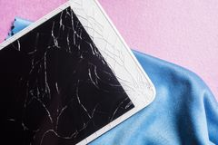 Broken mobile phone screen. On a pink background stock photo