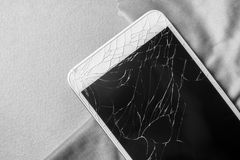 Broken mobile phone screen, close-up, black and white frame.  royalty free stock photography