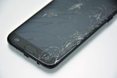 Broken mobile phone screen. LCD screen of a broken, cracked and unusable mobile phone royalty free stock image