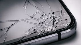 Broken mobile phone screen. Weak glass in modern gadgets. Broken mobile phone screen close up. Weak glass in modern gadgets royalty free stock photo