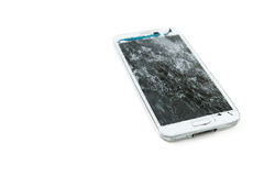 Broken mobile phone. On white background royalty free stock photography