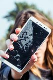 Broken mobile screen on the road or concrete floor stock photo