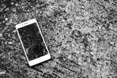 Broken mobile screen. Broken mobile screen on the road or concrete floor royalty free stock photography