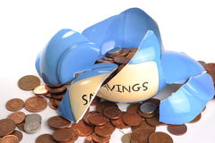 Broken money box. Photograph of a broken money box and loose change Stock Images
