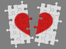 Broken mosaic from puzzles with symbol of heart Royalty Free Stock Photos