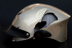 Broken motobike helmet on black background Stock Photography