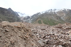 Broken mountain road. The mountain road destroyed after melting snow Royalty Free Stock Photos