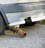 Broken muffler Stock Photos