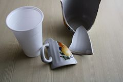 Broken mug with fragments on the table.  stock photos