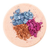 Broken multicolor eyeshadow over makeup sponge Stock Image