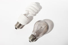 Broken and new light bulbs Stock Images