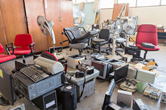 Broken office chairs and electronic waste. In the store room royalty free stock photography
