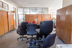 Broken office chairs and wooden cabinet. In the store room royalty free stock photo