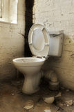 Broken old abandoned toilet Stock Images