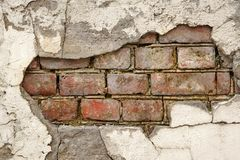 Broken Old Bricklaying From Red White Bricks And Damaged Plaster Royalty Free Stock Photography