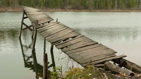 Broken old Bridge in the Forest Lake. Autumn daytime. Smooth dolly shot.  stock video