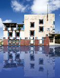 Broken old building with water reflection Stock Photo