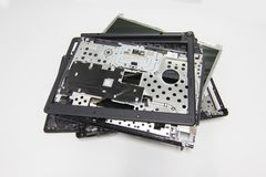 A broken old Computer laptop and notebook crash. Concept Laptop disassembling in repair shop isolated white background stock photos
