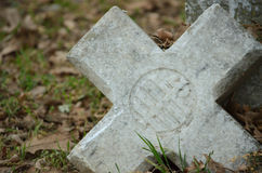 Broken Old Cross. Gravestone in a cementary stock photography