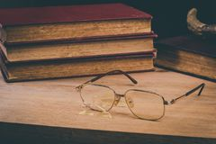 Broken old eyeglasses royalty free stock images