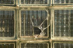 Broken old glass brick wall. Postmodern socialist style Royalty Free Stock Photography