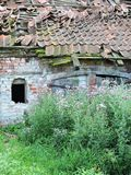 Broken old home in village, Lithuania. Old broken home wall and roof in village stock images