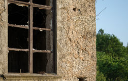 Broken. A old house with a broken window stock image