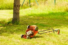 Broken old lawnmower in backyard grass Stock Images