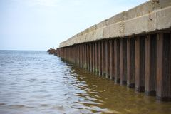 Broken old pier. Stock Photos