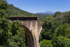 Broken old stone bridge. In Castellfollit, Spain royalty free stock image