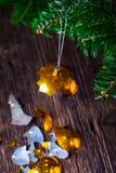 Broken old vintage Christmas ball and christmas tree. Broken old vintage Christmas ball on wooden table. Christmas lights and Christmas tree Royalty Free Stock Photos