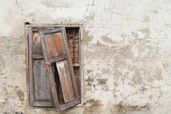 Broken old window on old cracked wall. Found in a soi downtown Bangkok, Thailand stock photography
