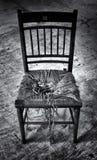 Broken old wooden chair in derelict background Stock Photography