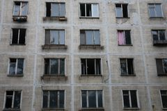 Broken and open windows in abandoned apartment building royalty free stock images
