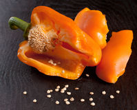 Broken orange bell pepper Royalty Free Stock Image