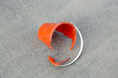 Broken Orange Bucket on Asphalt Stock Image