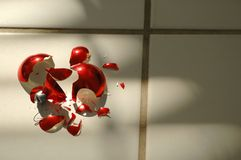 Broken_Ornament_Three. Shattered Red Christmas Ornament royalty free stock image