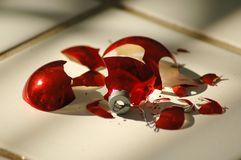 Broken Ornament Two. Shattered Red Christmas Ornament royalty free stock photo