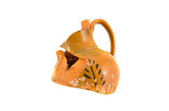 Broken ornamental ancient clay jug isolated on white Stock Image