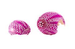 Broken ornamental easter egg isolated on white Royalty Free Stock Image